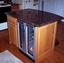 T A Double Door Wine Cooler Built Under The Counter